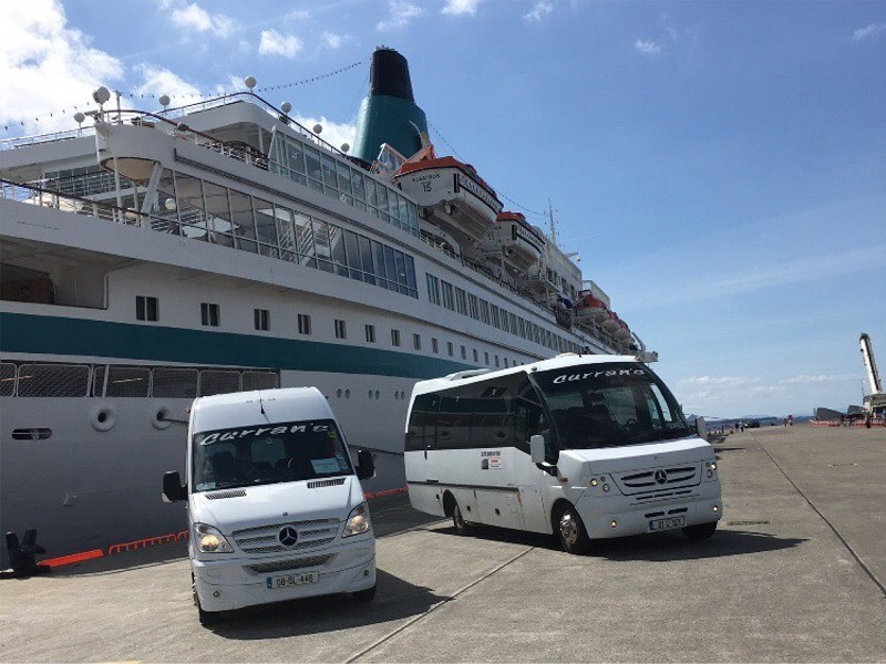MS Albatross Cruise ship in Killybegs Harbour greeted by Curran Coaches Tour Buses, County Donegal, Ireland